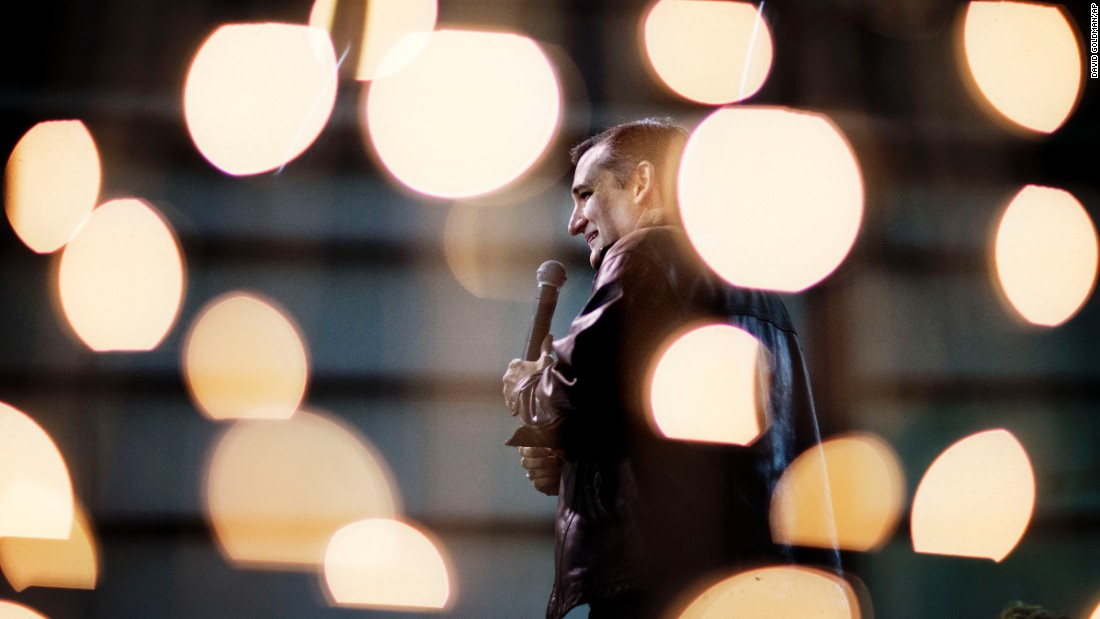Republican presidential candidate Sen. Ted Cruz is seen through Christmas lights as he speaks during a campaign event on Friday, December 18, in Kennesaw, Georgia.