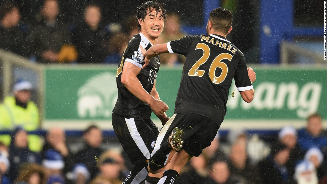 Shinji Okazaki (L) of Leicester City celebrates scoring his team's third goal with his team mate Riyad Mahrez. The Foxes beat Everton 3-2 at Goodison Park.