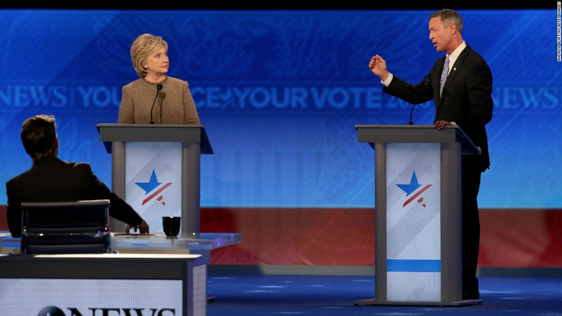 O'Malley speaks during the debate as Clinton looks on.