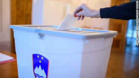 A Slovenian voter takes part in a referendum on legalizing same-sex marriage Sunday.