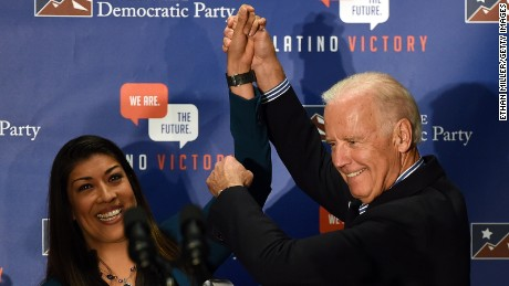 Democratic candidate for lieutenant governor and current Nevada Assemblywoman Lucy Flores (D-Las Vegas) (L) introduces U.S. Vice President Joe Biden at a get-out-the-vote rally at a union hall on November 1, 2014 in Las Vegas, Nevada.