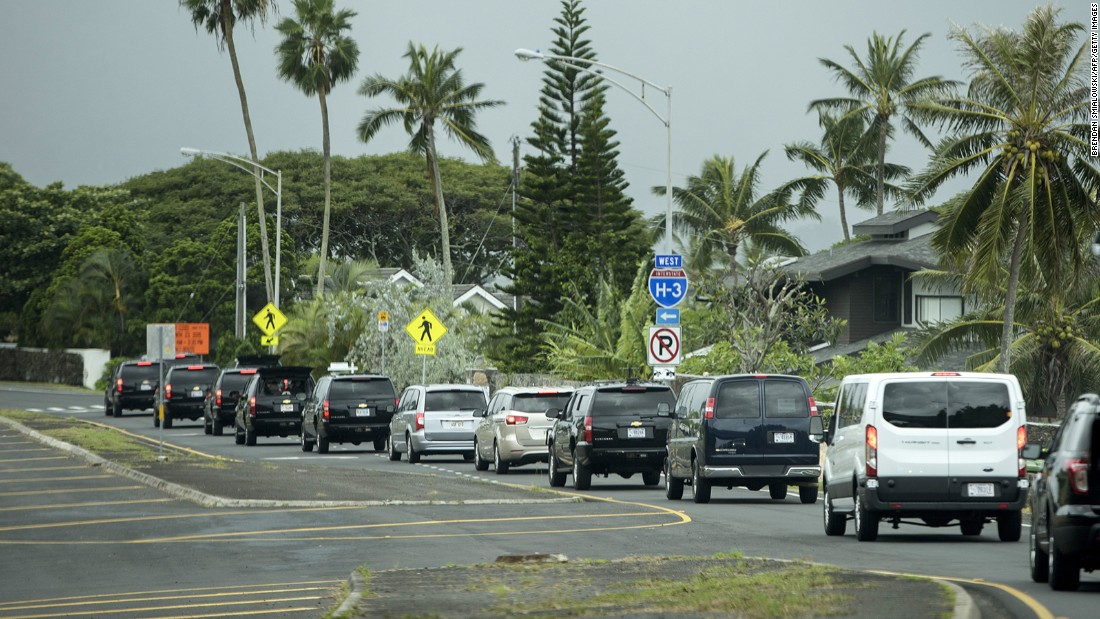 A motorcade takes the Obama family to a hike in Honolulu on Sunday.