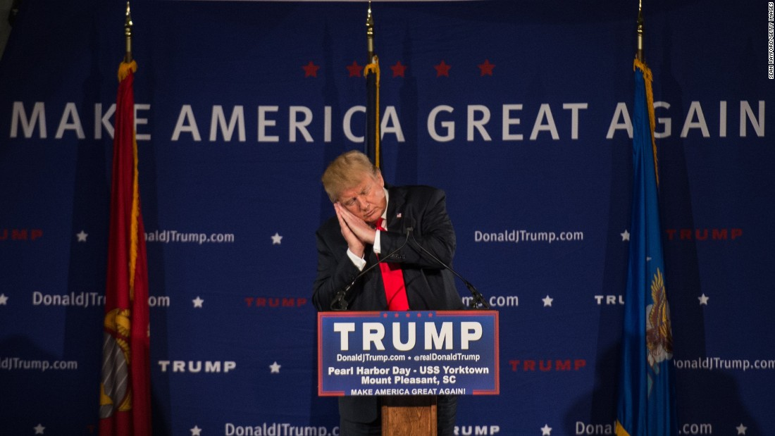 "Trump pretends to sleep December 7 as he references fellow candidate Jeb Bush at a Pearl Harbor Day Rally in Mount Pleasant, South Carolina. It was here that Trump read a press release calling for a ""complete and total shutdown of Muslims entering the United States"" in light of the San Bernardino terror attacks."