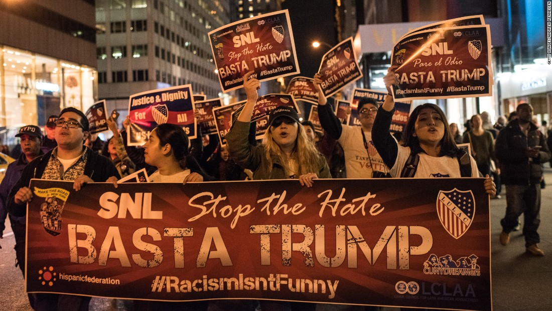 "Members of Latino organizations march from the Trump Tower to NBC studios in New York to protest Trump's ""Saturday Night Live"" appearance on November 7."