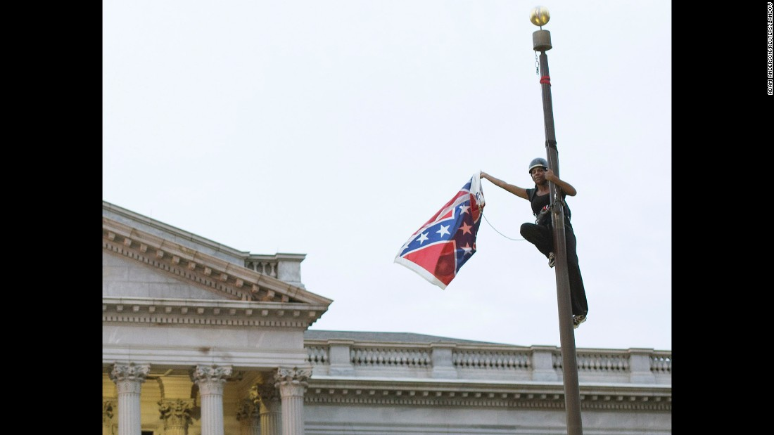 "A battle waged against the Confederate flag as a symbol of hatred after Dylann Roof was accused of killing nine people in a South Carolina church in an attempt to spark a race war. Activist Brittany ""Bree"" Newsome took the battle flag off the flagpole at the Statehouse in Columbia, South Carolina."