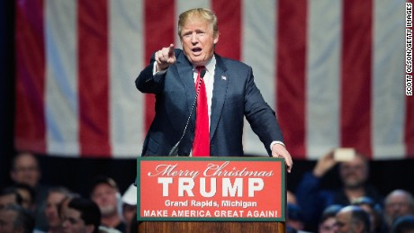 GRAND RAPIDS, MI - DECEMBER 21:  Republican presidential candidate Donald Trump speaks to guests at a campaign rally on December 21, 2015 in Grand Rapids, Michigan. The full-house event was repeatedly interrupted by protestors. Trump continues to lead the most polls in the race for the Republican nomination for president.  (Photo by Scott Olson/Getty Images)