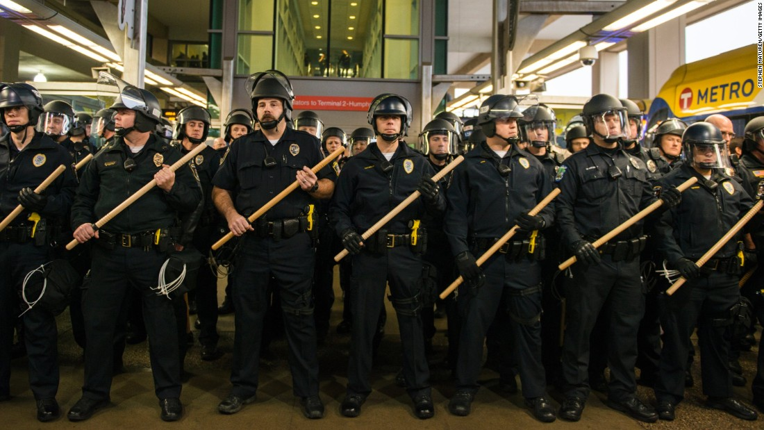 Police line up at the rail stop, where Black Lives Matter protesters attempted to enter the airport Wednesday.