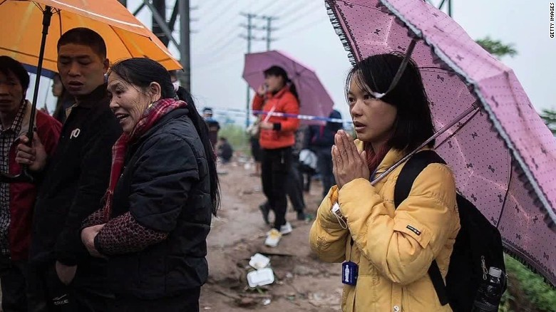 Families of Chinese landslide victims seek answers