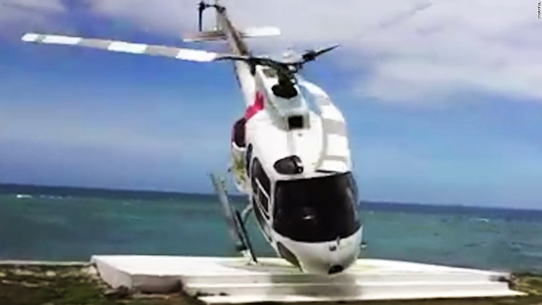 Helicopter comes flying at tourists