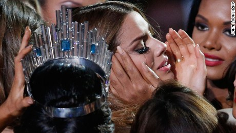 Other Miss Universe contestants comfort Miss Colombia Ariadna Gutierrez after she was incorrectly crowned Miss Universe at the pageant in Las Vegas on Sunday, December 20.