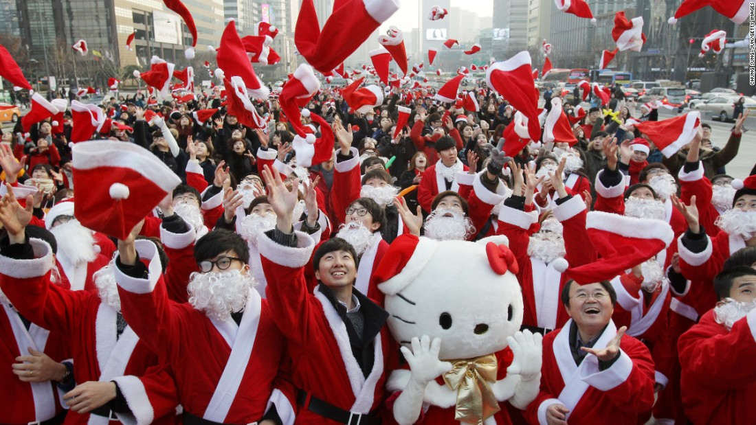 South Koreans wearing Santa Claus outfits promote a Christmas charity event in Seoul, South Korea, on Thursday.