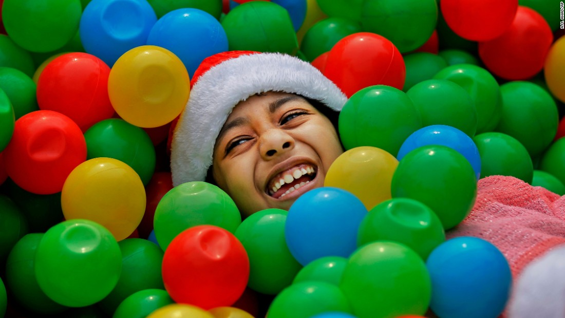 A girl plays in a plastic ball pit at a Christmas party in Dhaka, Bangladesh, on December 25.