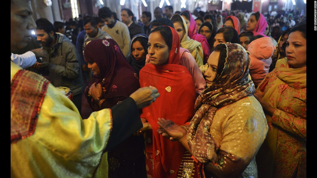 Pakistani Christians attend Christmas Day prayers at the Sacred Heart Cathedral Church in Lahore, Pakistan, on December 25.