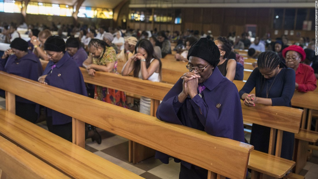 People pray as they attend a Christmas Mass at the Regina Mundi Church in Soweto, South Africa.