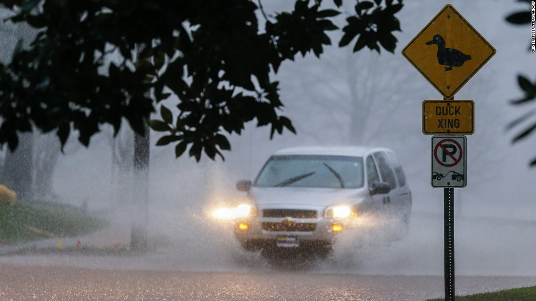 A vehicle drives through a flooded street as a record-breaking downpour continued in Avondale Estates, Georgia, on Thursday.