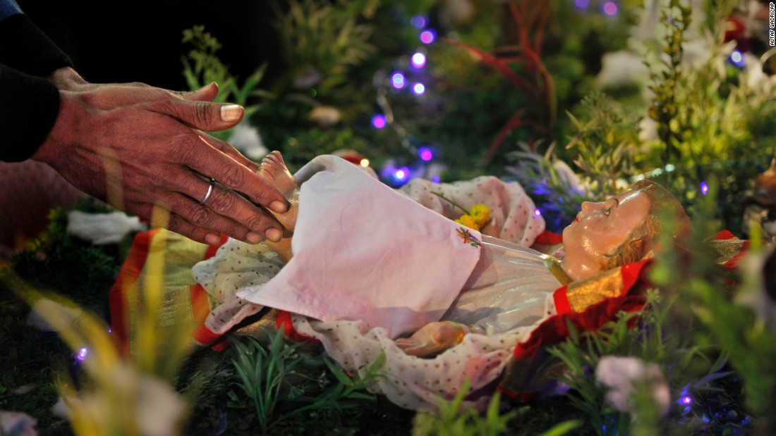 An Indian Christian prays at Sacred Heart Cathedral in New Delhi on Friday, December 25.