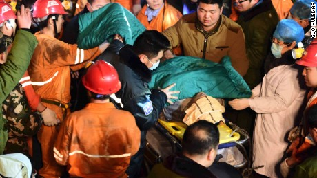 A trapped miner is rescued from a collapsed gypsum mine in Pingyi County, in east China's Shandong Province, on Friday, December 25.