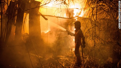 A firefighter battles against a blaze outbreak in northwest Spain.