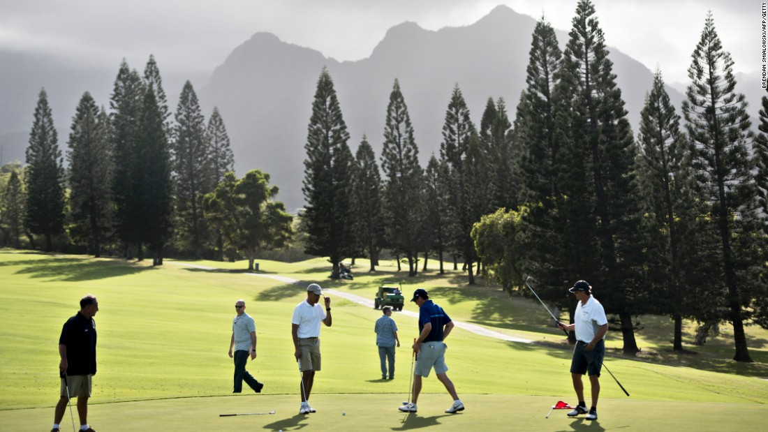 Obama golfs with longtime friends and former schoolmates from Hawaii: Bobby Titcomb, from left, Obama, Mike Ramos and Greg Orme walk on the 18th green. Secret Service agents are in the background.