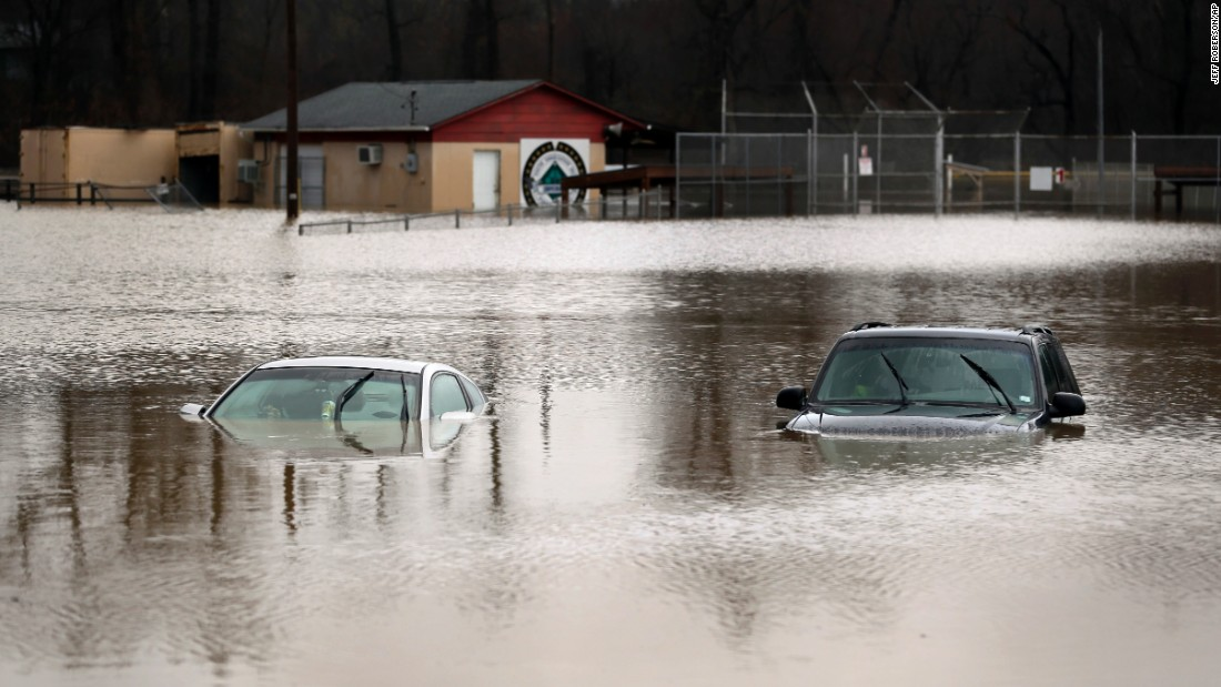 Cars are submerged in flood waters in Kimmswick on December 28.