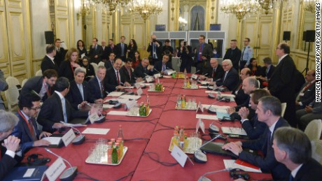 U.S. Secretary of State John Kerry meets with French Foreign Minister Laurent Fabius (4th R) and other leaders--all male-- at the start of the ministerial meeting on Syria in Paris in December.