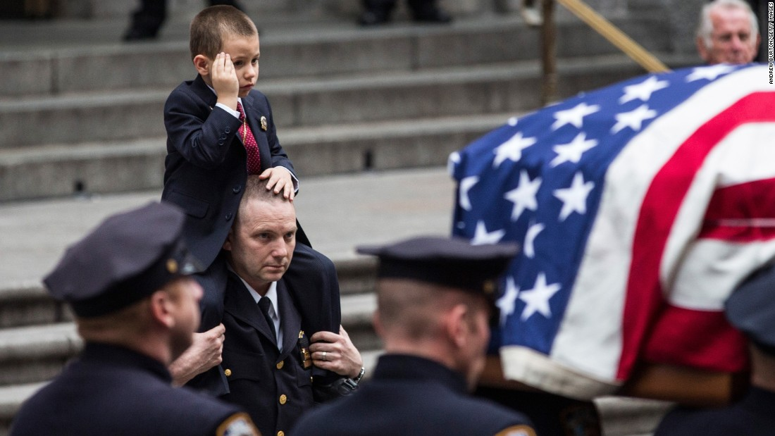 "Ryan Lemm salutes his father's casket after a funeral in New York City on Wednesday, December 30. Joseph Lemm, a New York police veteran and National Guardsman, <a href=""http://www.cnn.com/2015/12/22/asia/nato-members-killed-bagram-afghanistan/"" target=""_blank"">was killed in Afghanistan.</a> He was 45."