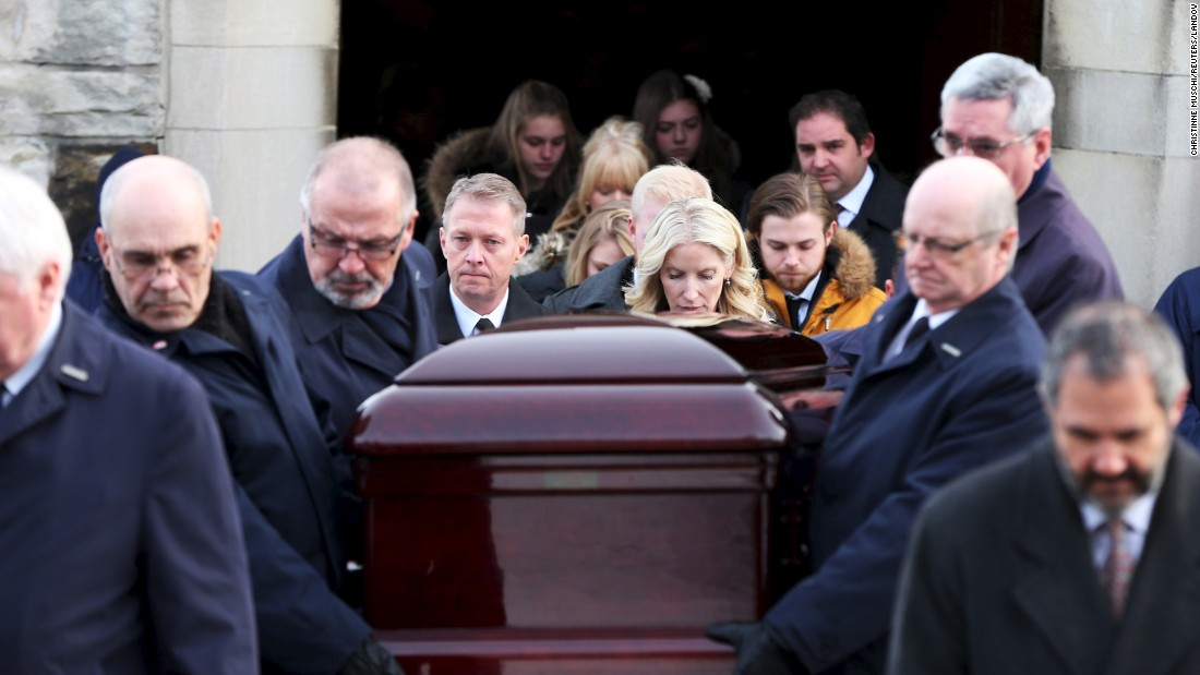 The casket of Hall of Fame hockey player Dickie Moore is carried from a church following his funeral in Montreal on Monday, December 28. During his career, Moore won six Stanley Cups with the NHL's Montreal Canadiens. He was 84.