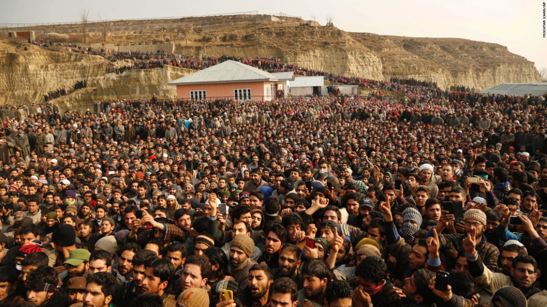 Kashmiri villagers attend the funeral of Manzoor Ahmad Bhat during his funeral in Pulwama, India, on Thursday, December 31. He was one of two suspected militants killed in a gunfight with security forces, police said.