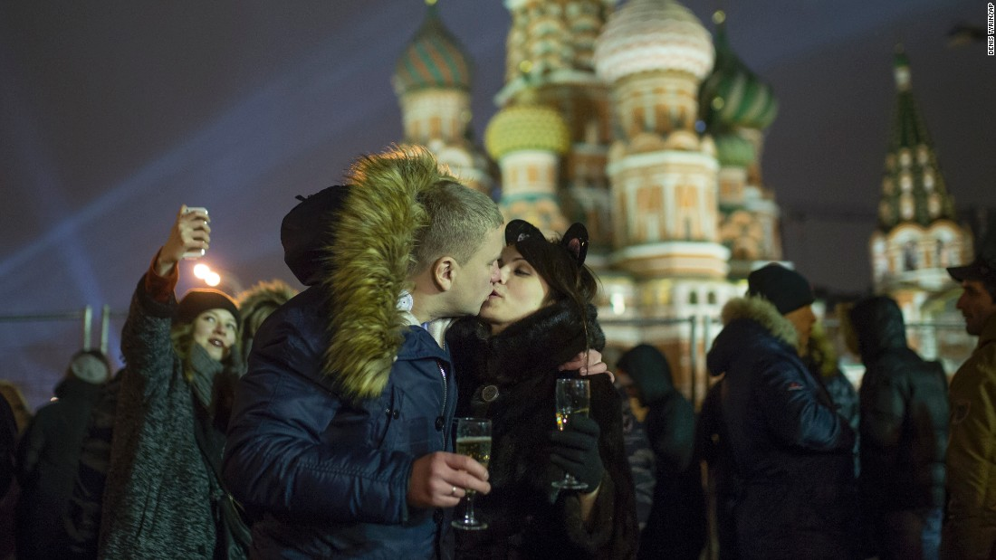 A young couple shares a tender moment in Moscow.