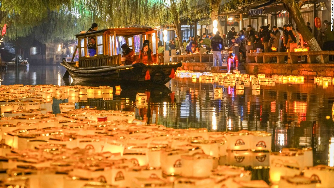 Lanterns float on a river in Zhouzhuang, China.