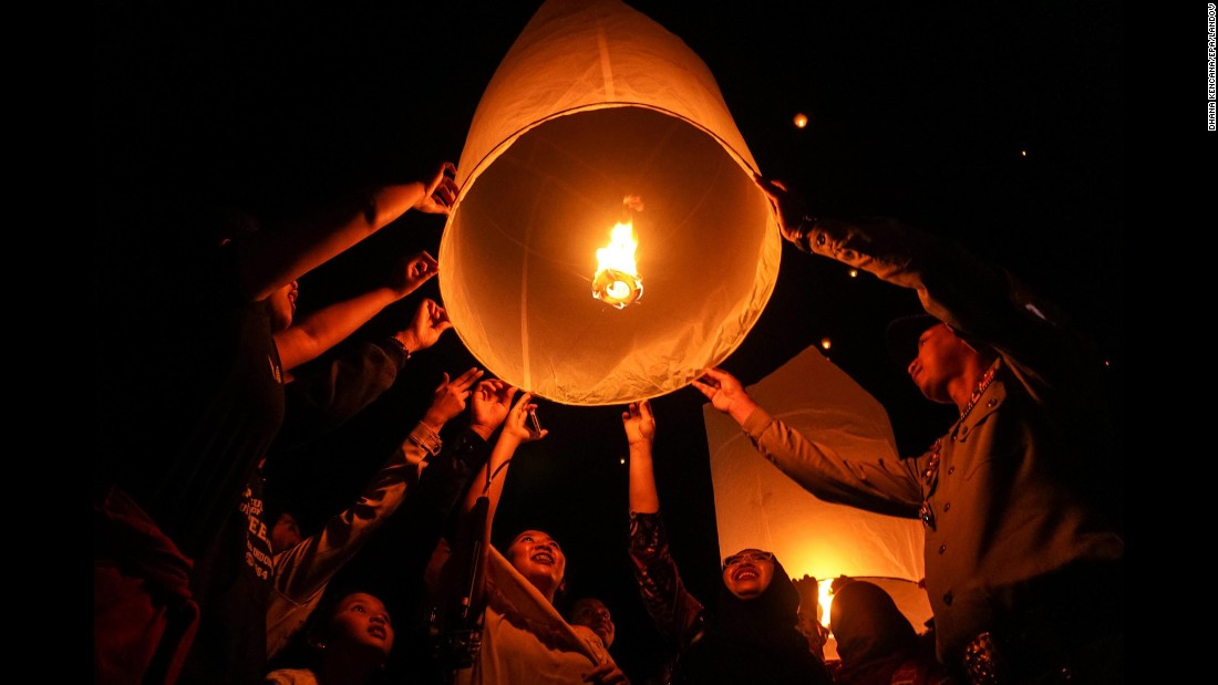 Indonesians release sky lanterns during the New Year celebrations in Magelang, Indonesia.
