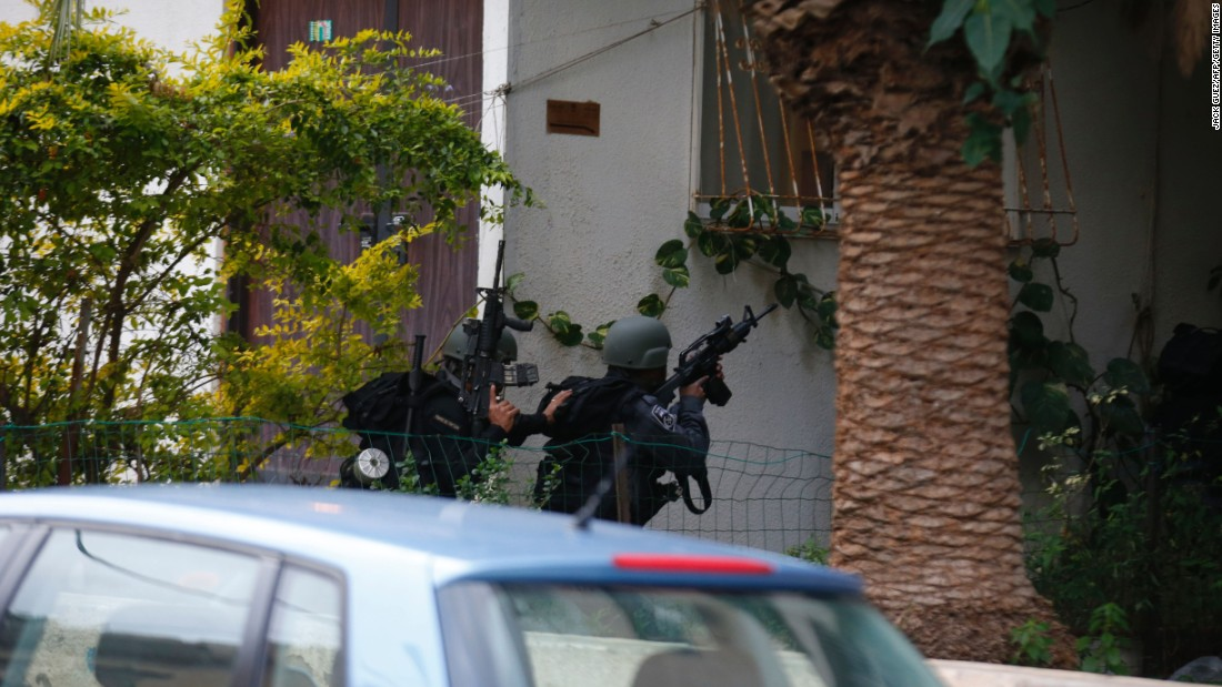 Israeli security forces search for the suspect.