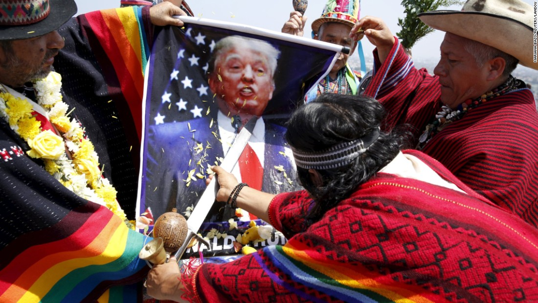 Shamans in Lima, Peru, hold a poster of U.S. presidential candidate Donald Trump as they perform a ritual of predictions on Tuesday, December 29. The ritual is an end-of-year tradition for the shamans, who called for world peace and wished good luck for the upcoming elections in the United States and Peru.