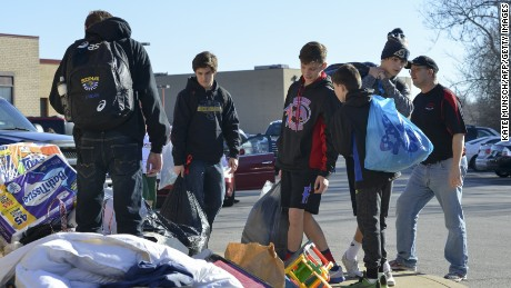 Donations are collected by students and volunteers at Fox High School in Arnold, Missouri on January 2, 2016, for flood victims. Missouri and Illinois have been hard hit by the record-breaking and relentless deluge, with many river levels in the area at all-time highs. The death toll from the flooding in the Midwest is now at 23, CNN said. Fifteen of the dead were in Missouri and eight in Illinois. Swaths of the United States have been buffeted over the holiday season by tornadoes, storms and torrential rain, while the US East Coast has seen unseasonably warm weather. AFP PHOTO/KATE MUNSCHKate Munsch/AFP/Getty Image