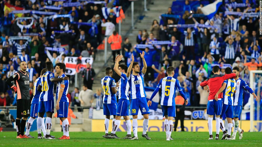 Espanyol players salute the club's fans at the final whistle.