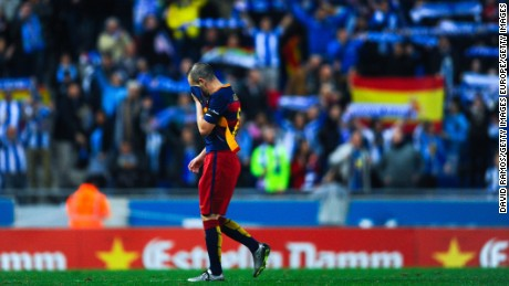 Barcelona playmaker Andres Iniesta leaves the pitch dejected at the end of Saturday's match with Espanyol.