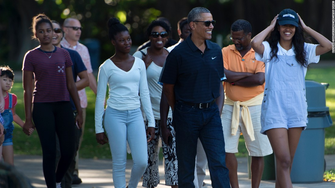 The President walks with his daughters and other members of his family during a visit to the Honolulu Zoo on Saturday, January 2.