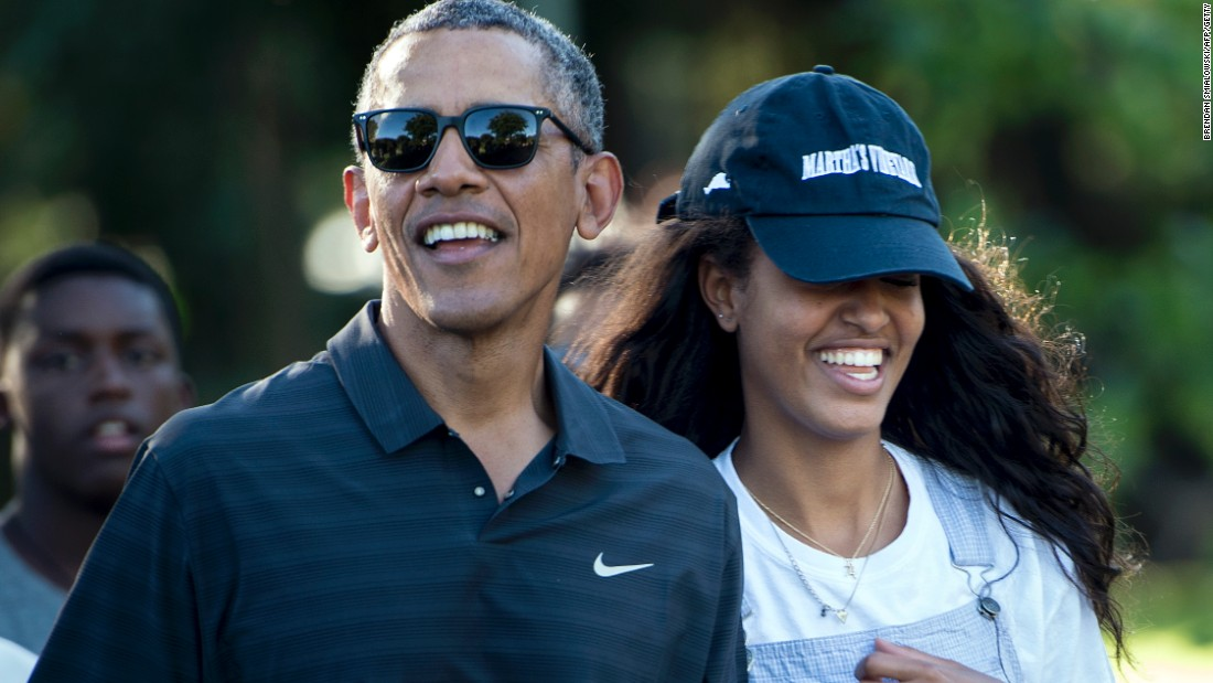 Obama and his daughter Malia walk during a visit to the Honolulu Zoo on January 2.