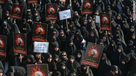 Iranian women attend a rally to protest the execution by Saudi Arabia last week of Sheikh Nimr al-Nimr, a prominent opposition Shiite cleric, shown in the posters, in Tehran, Iran, Monday, Jan. 4, 2016. Allies of Saudi Arabia followed the kingdom's lead and began scaling back diplomatic ties to Iran on Monday after the ransacking of Saudi diplomatic missions in the Islamic Republic, violence sparked by the Saudi execution of al-Nimr. (AP Photo/Vahid Salemi)