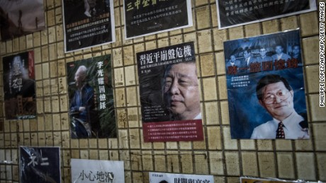 Posters of books about China's politics, including some featuring current Chinese President Xi Jinping (center), are seen displayed in the staircase leading to a bookshop in Hong Kong on January 4, 2016.
