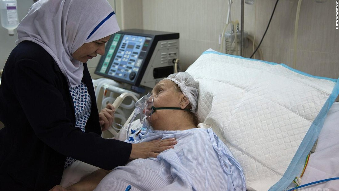 Some of today's refugees are leaving behind wealthy lifestyles which brings a new range of diseases stemming from these lifestyles such as diabetes, heart disease and hypertension. Pictured, a Syrian refugee is comforted by a nurse as she is treated for vascular disease,kidney problems and diabetes complications in Egypt.
