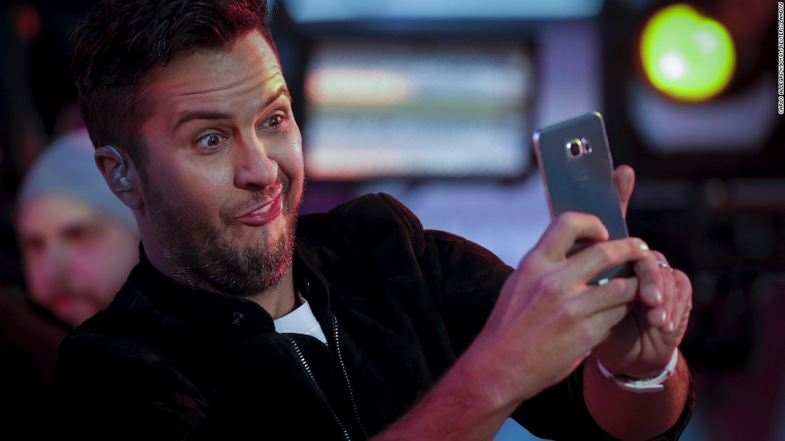 Country singer Luke Bryan takes a selfie during his performance in New York's Times Square on Thursday, December 31.