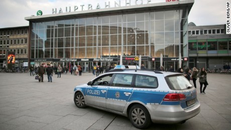 A police car passes the central railway station in Cologne, Germany near where a series of sex assaults allegedly occurred on New Year's Eve.