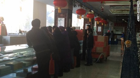 People line up to buy the special monkey stamps in a Beijing post office on Wednesday, January 6, 2016.