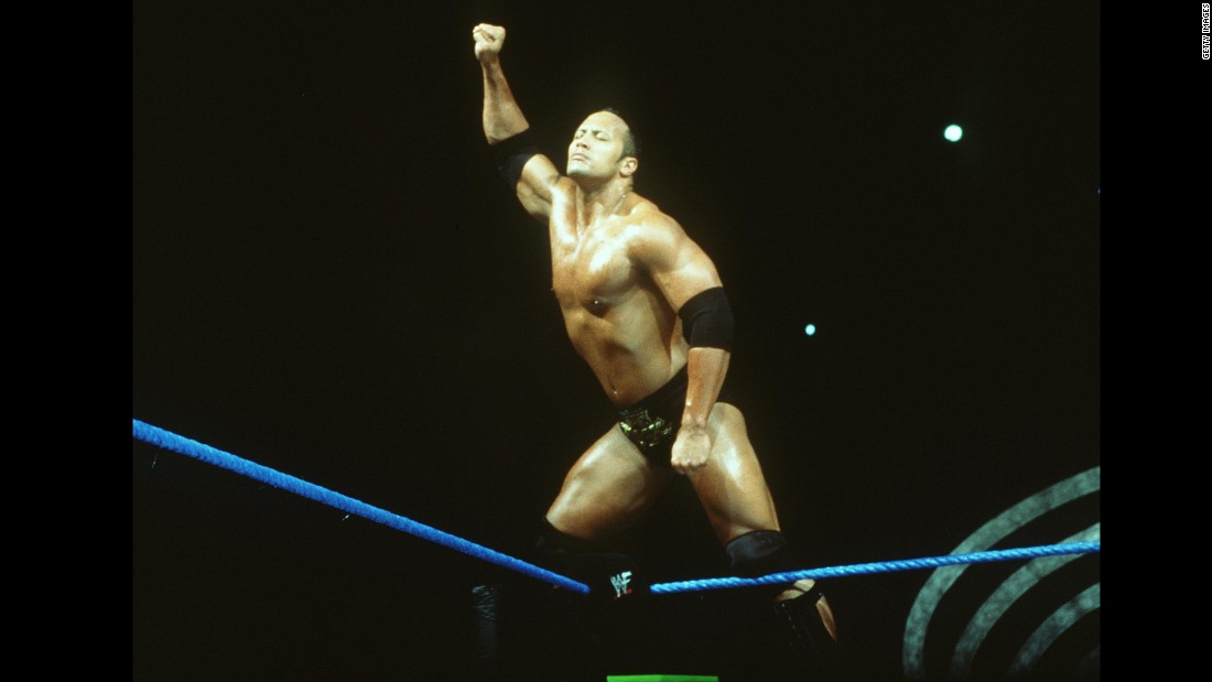 "Johnson followed in the footsteps of his father, Rocky, and maternal grandfather, Peter Maivia, by becoming a professional wrestler in the late '90s. Holder of more than a dozen titles, the hugely popular Rock had only one question: ""Can you smell what The Rock is cooking?"""