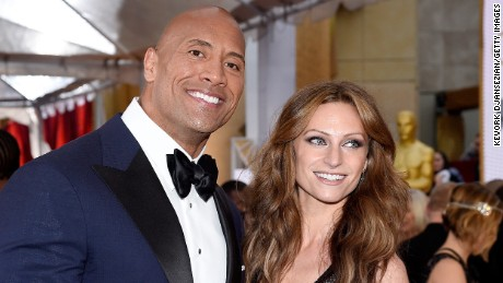 HOLLYWOOD, CA - FEBRUARY 22:  Actor Dwayne 'The Rock' Johnson (L) and singer Lauren Hashian attends the 87th Annual Academy Awards at Hollywood & Highland Center on February 22, 2015 in Hollywood, California.  (Photo by Kevork Djansezian/Getty Images)