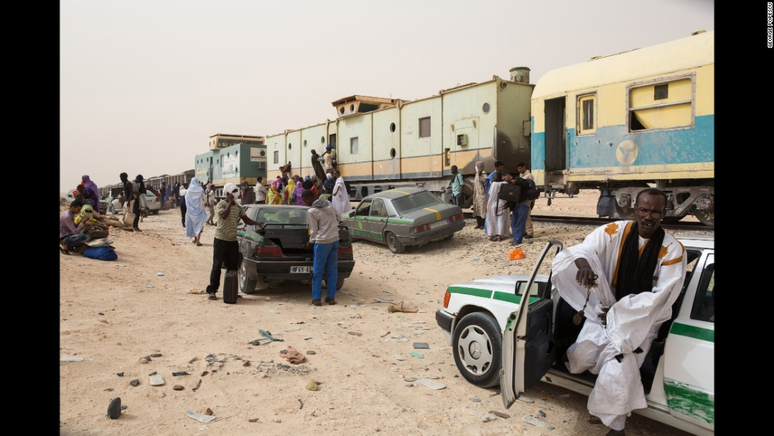 People exit the train after arriving at the Nouadhibou harbor.
