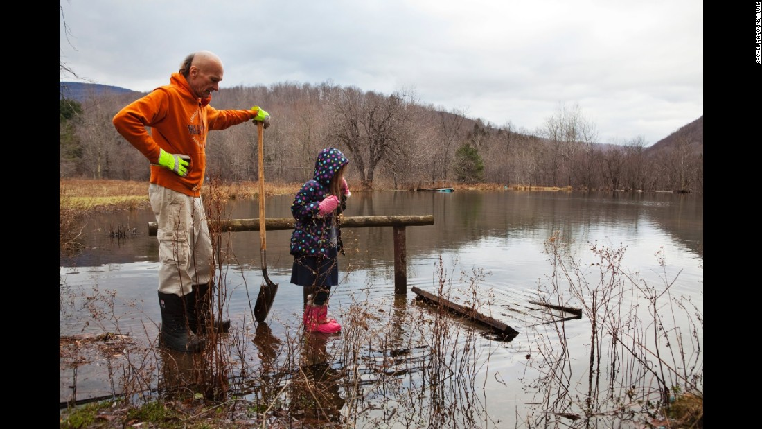True and her father assess damage to a sinking bridge in 2011. She assists her father with outdoor tasks and is being taught various subjects with an emphasis on religion and music.