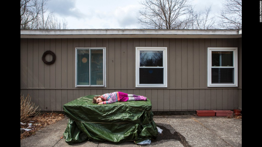 Rosabel lies outside her house in 2013.