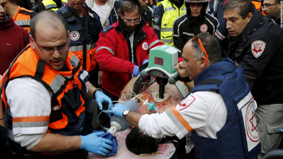 "Medics move a wounded person from the scene of a shooting in Tel Aviv, Israel, on Friday, January 1. A gunman <a href=""http://www.cnn.com/2016/01/02/middleeast/tel-aviv-pub-shooting/"" target=""_blank"">sprayed bullets near a pub,</a> killing two people and injuring at least eight others before fleeing, police said."